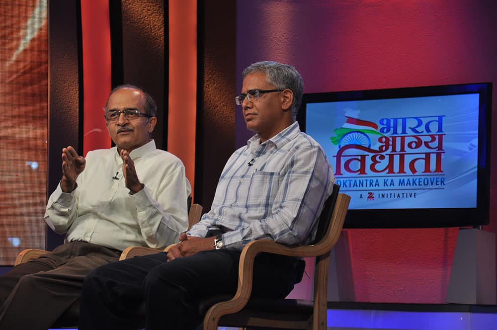 Prashant Bhushan, Supreme Court advocate and RK Misra, activist arguing over the issue of corruption.