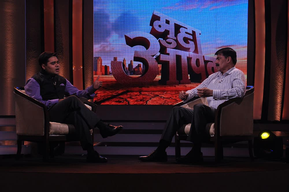 Anchor Amish Devgan, discussing the safety issue with K Vijay Kumar, IPS officer, on the sets of `Mudda Apka`.