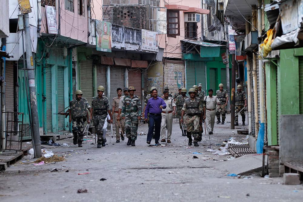 Officials and security forces patrol during an army-enforced curfew imposed following deadly clashes between Hindus and Muslims at Muzaffarnagar in Uttar Pradesh state.