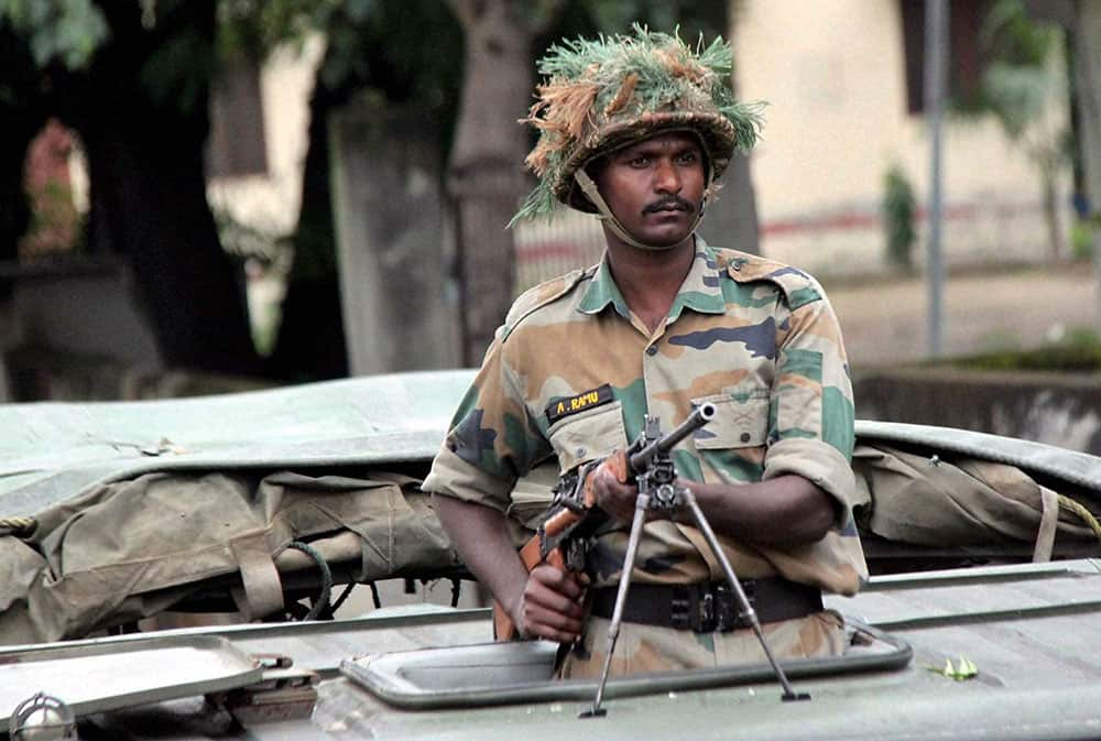 An Indian army soldier patrols following communal clashes at Muzaffarnagar.