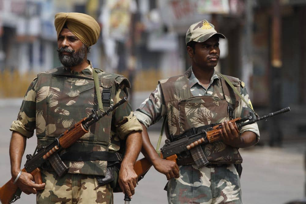 Paramilitary soldiers patrol a street during a curfew imposed following communal clashes in Muzaffarnagar, about 125 kilometers (78 miles) north of New Delhi.