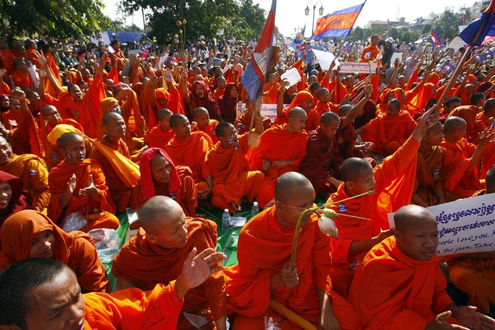 Cambodian Buddhist monks participate in a demonstration in Phnom Penh. More than 10,000 opposition supporters have gathered in Cambodia`s capital to repeat their demand for an investigation into alleged election irregularities, a day before the results of the poll six weeks ago are to be ratified.