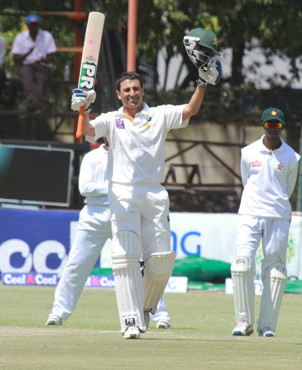 Pakistan batsman Younis Khan celebrates after scoring 100 runs on the fourth day of the first test match against Zimbabwe at Harare Sports Club in Harare.