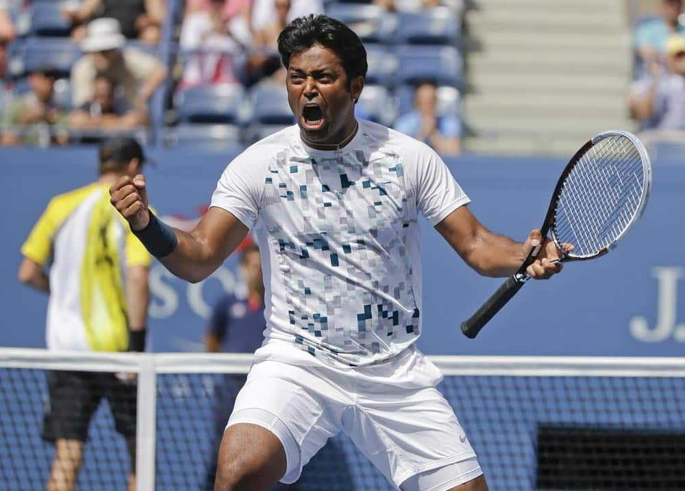 Leander Paes, turns and reacts to his partner Radek Stepanek, of the Czech Republic, during the men`s doubles quarterfinals against Mike and Bob Bryan at the 2013 US Open tennis tournament.