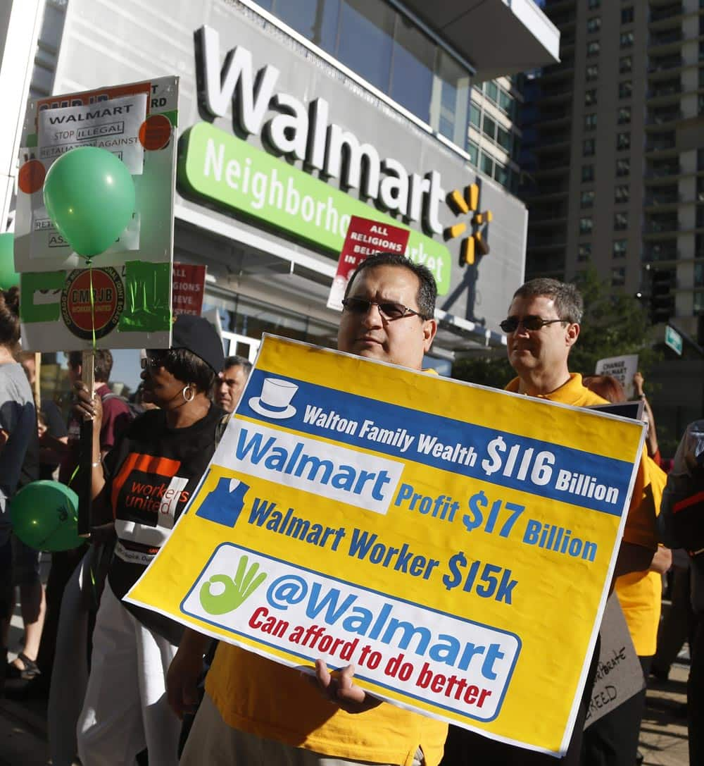 Protesters gather outside a Walmart Neighborhood Store for a peaceful demonstration, in Chicago. A handful of protesters participated in an act of civil disobedience by standing in the street and then taken into custody and given misdemeanor tickets.