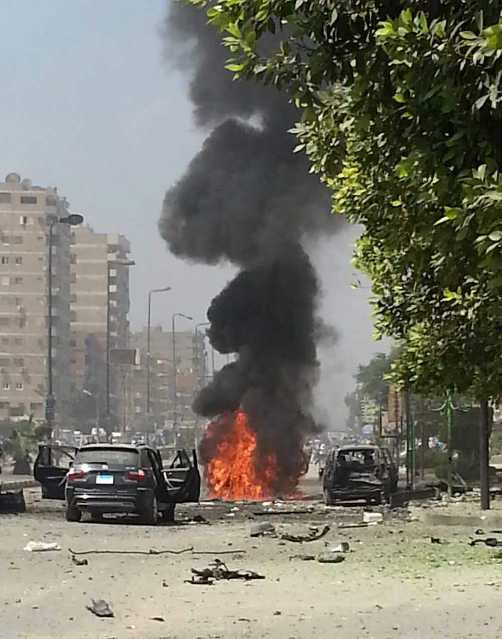 Black smoke billows from a burning car moments after a bomb attack targeted the convoy of Egypt`s Interior Minister Mohammed Ibrahim, in Nasr City, Egypt.