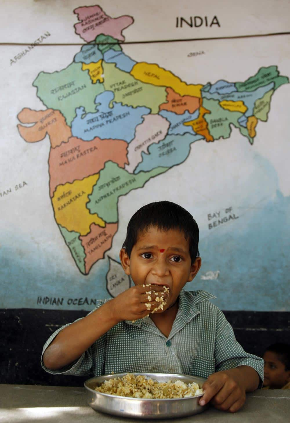 An Indian school boy eats a midday meal provided free at a government school in Hyderabad.