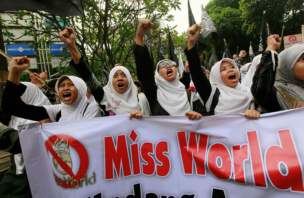Muslim women chant slogans during a protest demanding the cancellation of the Miss World pageant that will be held in Bali and Sentul, West Java later this month, in Jakarta.