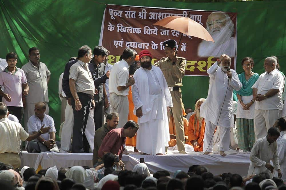 Controversial spiritual guru Asaram Bapu`s son Narayan Sai, center in red cap, attends a rally called in support of his father in New Delhi.
