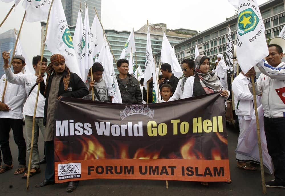 Muslim men display a banner during a protest calling for the cancellation of Miss World pageant in Jakarta. Hardliners in the world`s most populous Muslim country staged the protest Tuesday, demanding the government to ban the pageant that is scheduled to be held later this month saying that it goes against moral values.