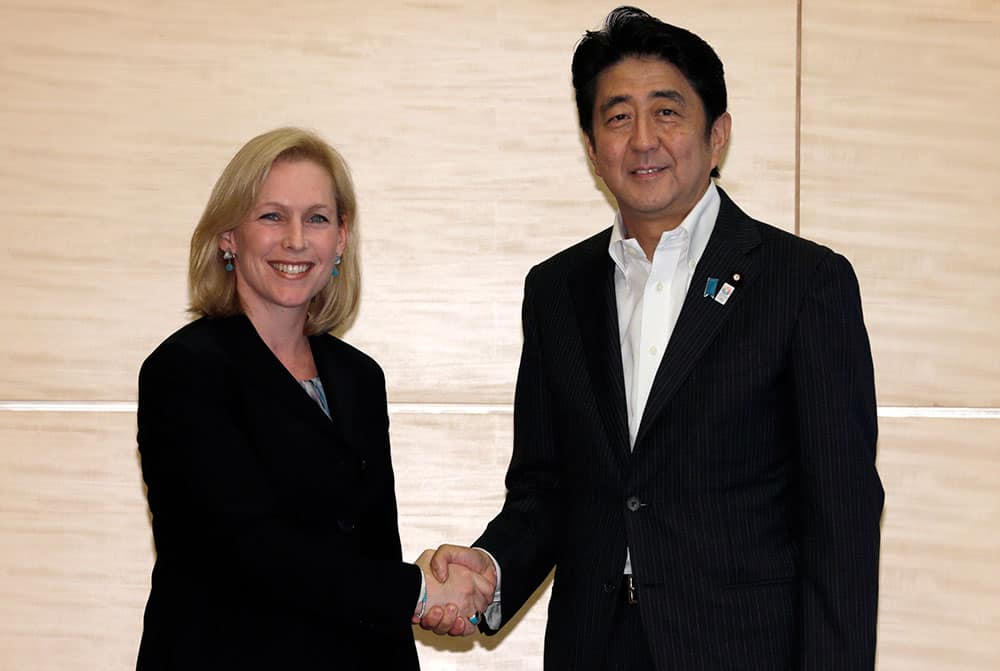 Japanese Prime Minister Shinzo Abe, right, shakes hands with US Sen. Kirsten Gillibrand, D-NY., chairwoman of the Armed Services personnel subcommittee during their meeting at the prime minister`s official residence in Tokyo.