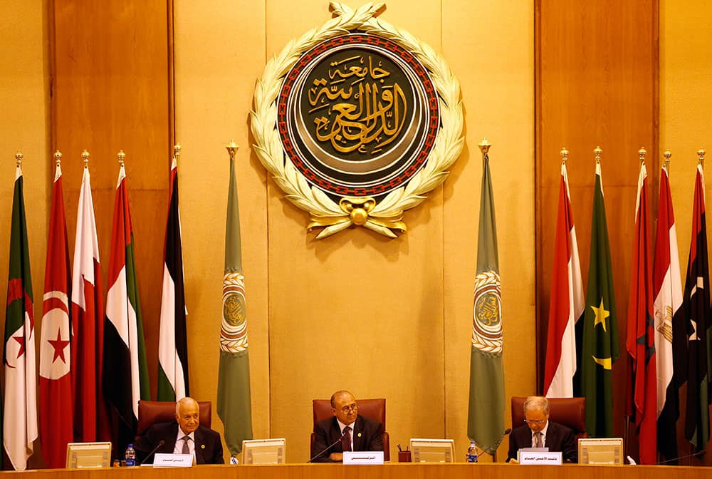 Libyan Foreign Minister Mohamed Abdulaziz, center, leads the Arab countries foreign ministers summit at the Arab League headquarters in Cairo, Egypt.