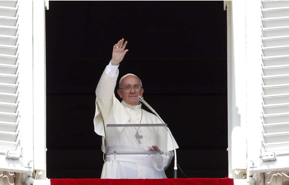 Pope Francis waves to faithful after reciting the Angelus prayer from his studio window overlooking St.Peter`s Square at the Vatican.