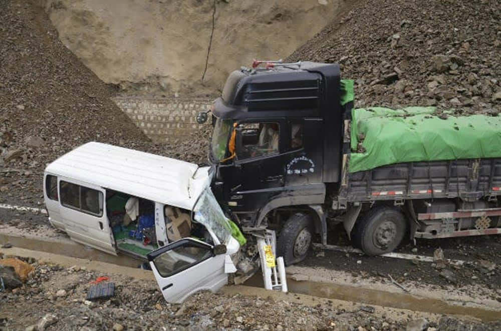 Two vehicles collide after an earthquake in Deqen County, southwest China`s Yunnan Province.