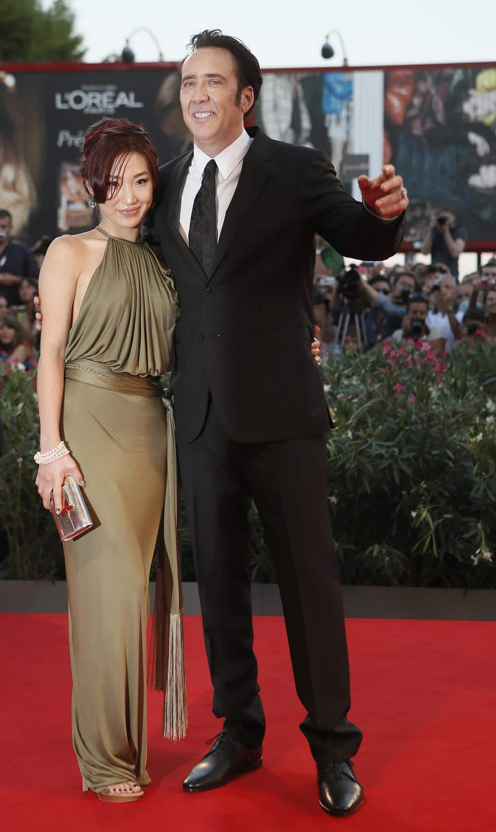 Actor Nicolas Cage, right, and his wife Alice Kim arrive for the screening of the film Joe at the 70th edition of the Venice Film Festival.