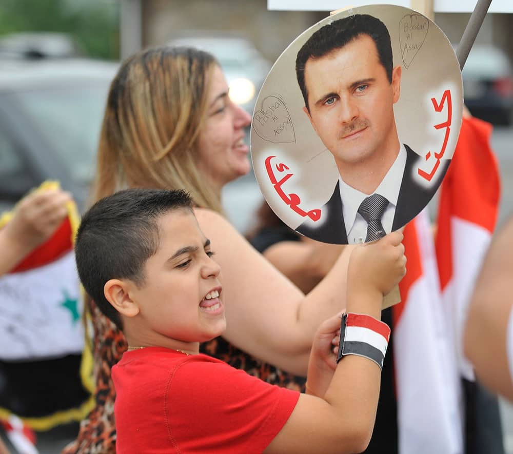 Members of the local Syrian community rally for the second day in a row against the United States` involvement in Syria, in Allentown, Pa.