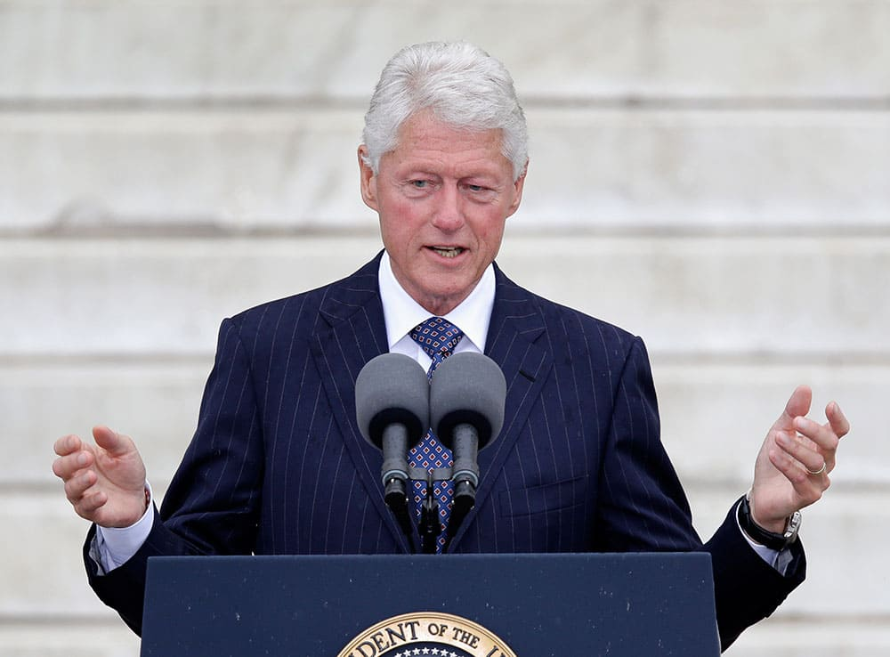 Former President Bill Clinton speaks at the Let Freedom Ring ceremony at the Lincoln Memorial in Washington to commemorate the 50th anniversary of the 1963 March on Washington for Jobs and Freedom.