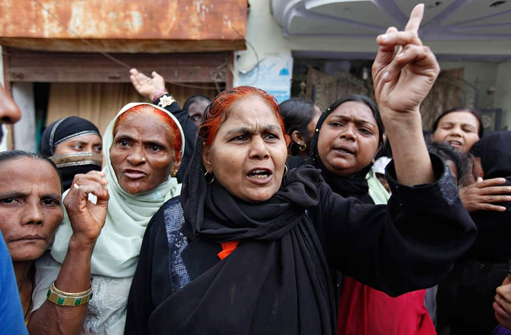 Angry residents of flood affected areas argue with authorities at a relief camp following heavy monsoon rains in Allahabad.