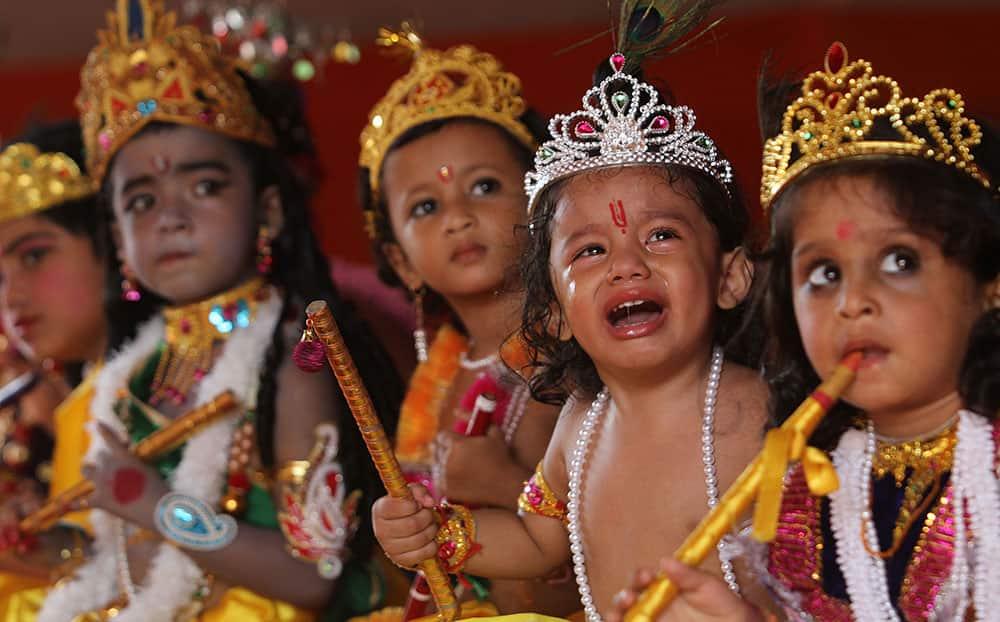 Children dressed as Hindu God Krishna participate in a function during the Janmashtami festival celebrations in Gauhati, India.