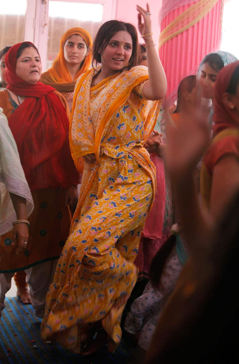 Devotees dance as they worship Lord Krishna as part of Janamashtami celebrations at the ISKON temple in Jammu, India.