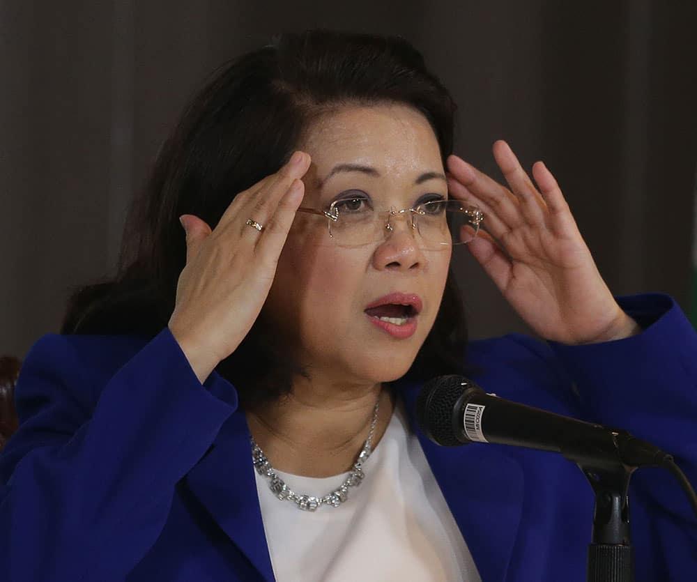 Philippine Chief Justice María Lourdes Sereno gestures during a rare press conference in Manila, Philippines.