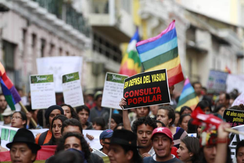 People demonstrate against the government`s decision to allow oil drilling in the Yasuni National Park, a rainforest amazon preserve, in Quito, Ecuador.