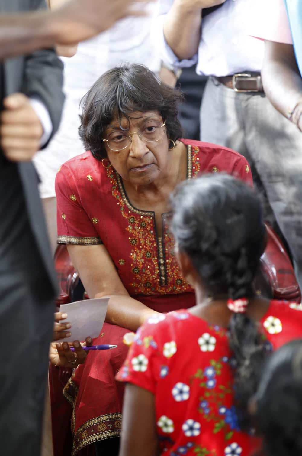 U.N. High Commissioner for Human Rights Navi Pillay listens to an ethnic Tamil war survivor during her visit to Mullivaikkal, Sri Lanka.