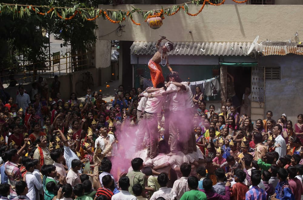 Students form a human pyramid to break an earthen pot during the Janmashtami festival, in Ahmadabad.
