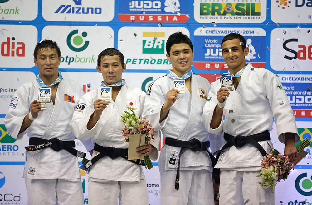 Medal winners from the -60kg category at the World Judo Championships, from left to right, silver medal winner Amartuvshin Dashdavaa of Mongolia, gold medal winner Naohisa Takato of Japan, and bronze medal winners Won Jin Kim from South Korea and Orkhan Safarov of Azerbaijan pose on the winners podium in Rio de Janeiro.