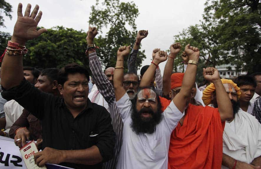 Indian supporters of Vishwa Hindu Parishad( VHP) or World Hindu Council shout slogans as they protest in Ahmedabad.