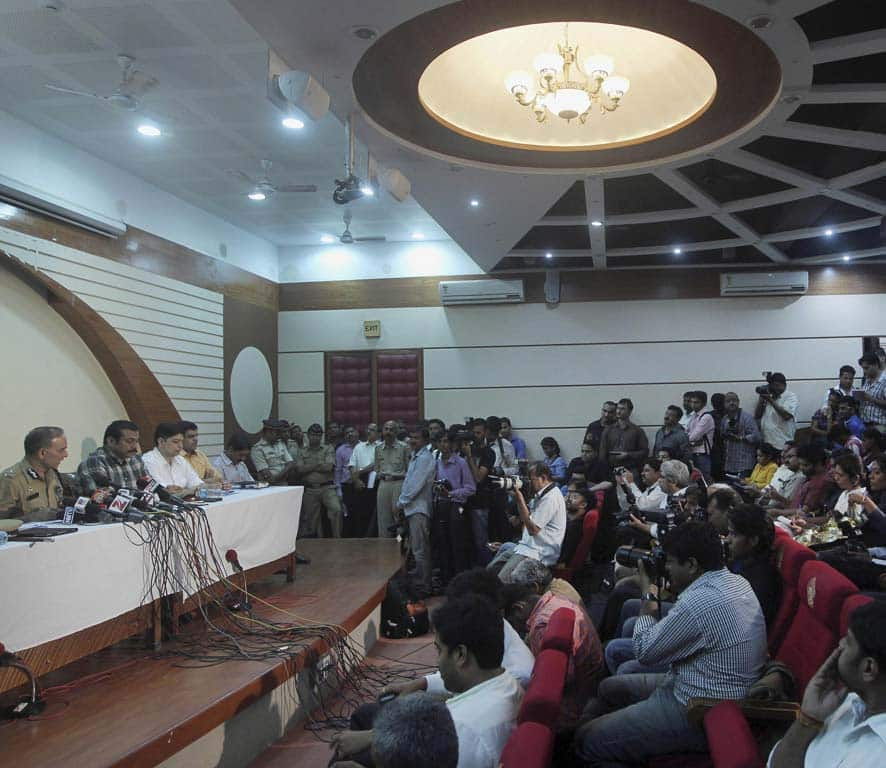 Journalists attend a press conference addressed by Mumbai Police Commissioner Satyapal Singh, left, in Mumbai.