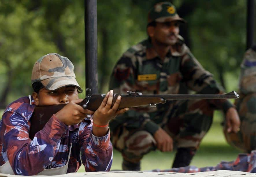An Indian girl cadet of the National Cadet Corps (NCC) takes aim during a training session in arms in Allahabad.