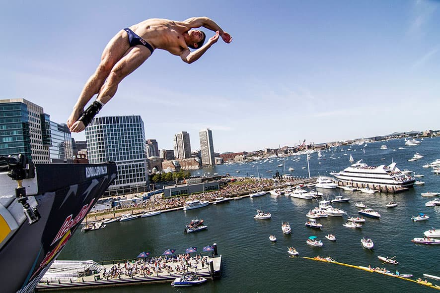 David Colturi of the USA dives from the 27.5 meter platform on the ICA building during the fifth stop of the Red Bull Cliff Diving World Series in Boston.