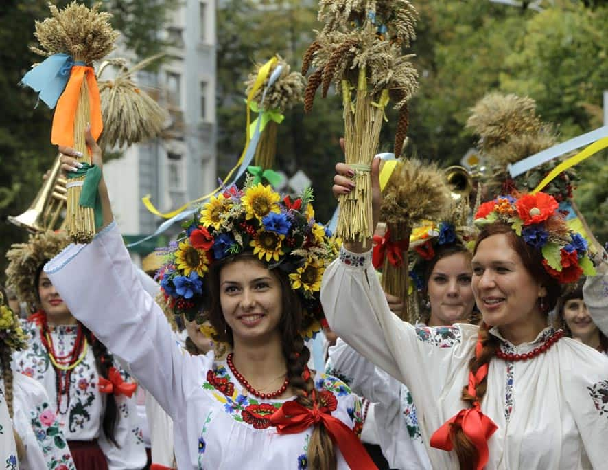 People dressed in Ukrainian folk costumes march during a parade to celebrate Ukraine`s Independence Day in Kiev, Ukraine.