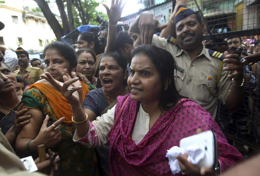 Hindu right-winged Shiv Sena activists shout slogans against the gang rape of a young photojournalist outside a court in the Indian financial hub of Mumbai.