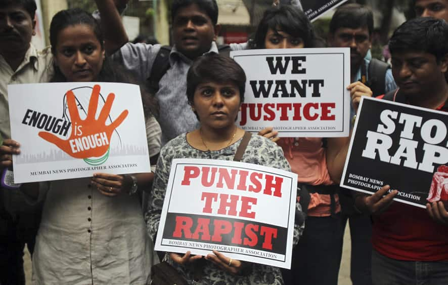 Photojournalists hold placards as they protest against the gang rape of a 22-year-old woman photojournalist in Mumbai.