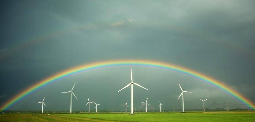A rainbow is pictured through the window of a train over a wind park near Wilster in northern Germany.