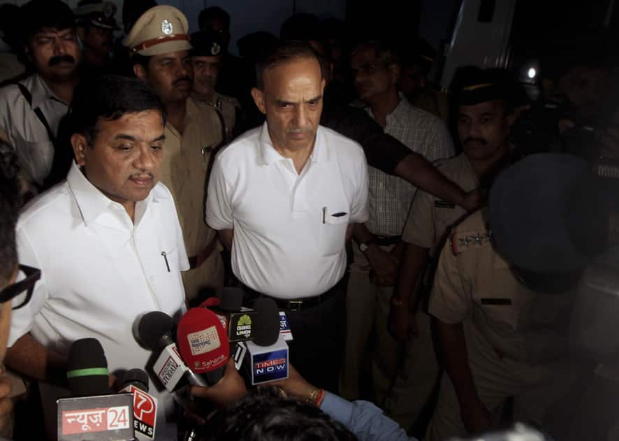 Maharashtra state home minister R.R. Patil and Mumbai Commissioner of police Satyapal Singh talk to the media at Jaslok Hospital where a 22-year-old woman photojournalist is admitted after she was allegedly gang raped in Mumbai.