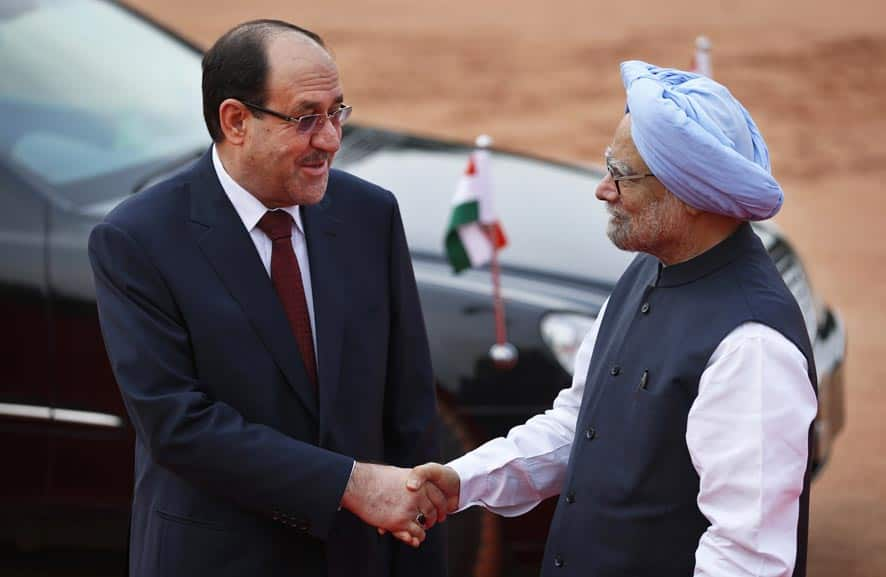 Iraqi Prime Minister Nouri al-Maliki, is greeted by Indian Prime Minister Manmohan Singh during his ceremonial reception at the Presidential Palace grounds in New Delhi.