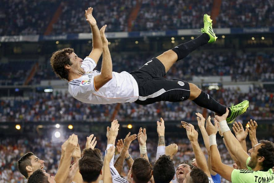 Real Madrid`s Raul Gonzalez Blanco is thrown in the air after the Santiago Bernabeu trophy soccer match between Real Madrid and Al Sadd at the Santiago Bernabeu stadium, in Madrid.