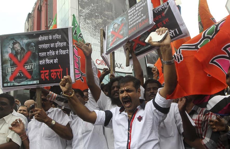 Protestors shout slogans against upcoming Bollywood film Madras Cafe in Mumbai.