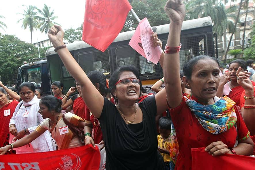 Women shout slogans during a protest against the killing of social activist Narendra Dabholkar in Mumbai.