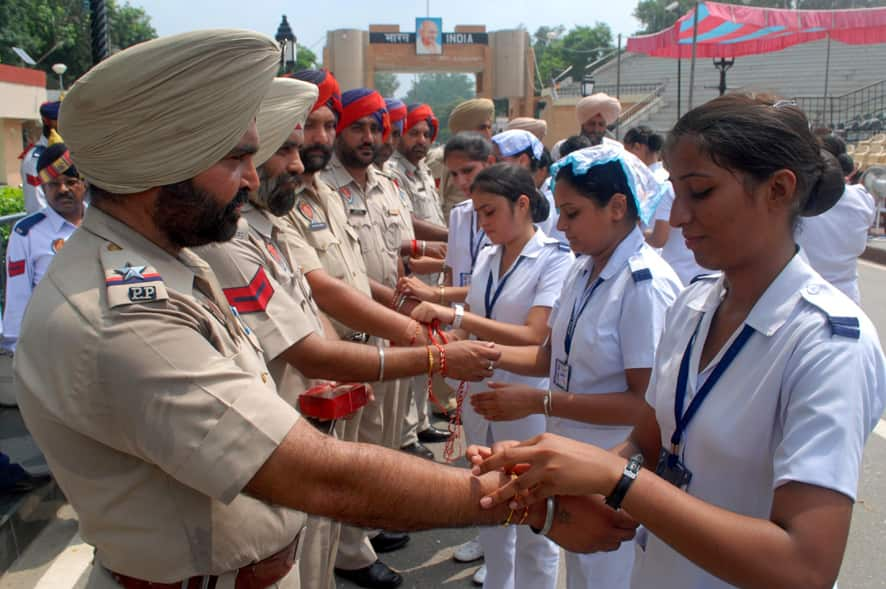 Girls tie rakhis on the wrists of Punjab policemen as a symbolic gesture to mark