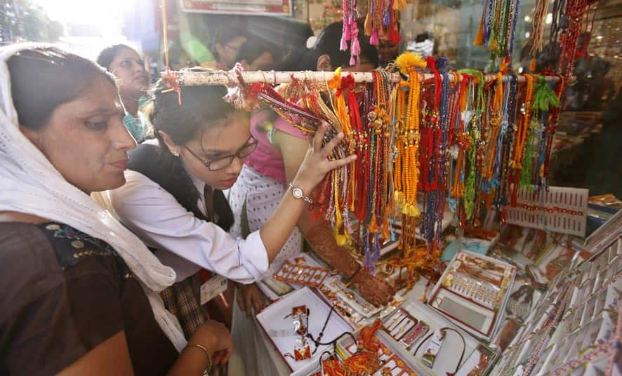 Indian girls shop for `Rakhis`, a sacred thread tied on the wrists of brothers on Raksha Bandhan festival in Varanasi.