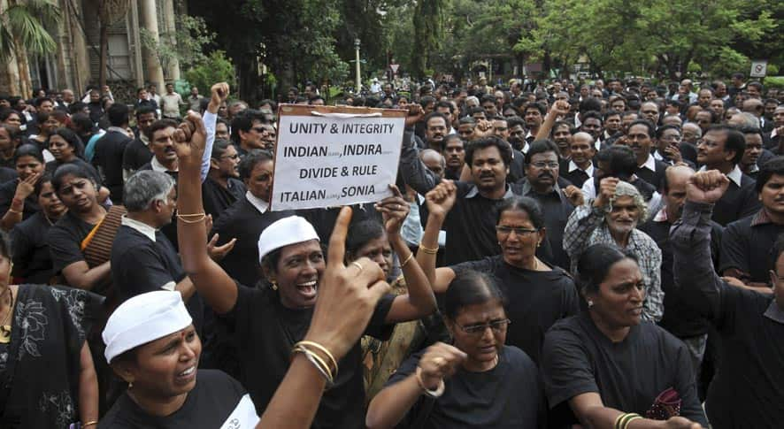 Andhra Pradesh state government employees shout slogans during a protest against the move to carve out a new state out of the existing state at Andhra Pradesh Secretariat in Hyderabad.