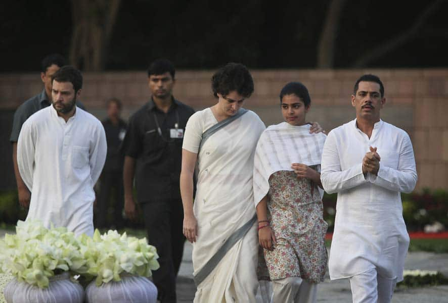 India's Congress Party President Sonia Gandhi`s daughter Priyanka Vadra, center, accompanied by her daughter Miraya Vadra, second right and husband Robert Vadra, right, pays tributes to former Indian Prime Minister Rajiv Gandhi on his birth anniversary at his memorial in New Delhi.