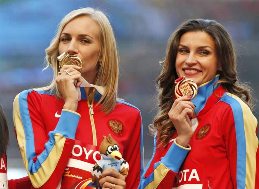 Russia`s Svetlana Shkolina, left, and Russia`s Anna Chicherova pose with their medals on the podium for the women`s high jump at the World Athletics Championships in the Luzhniki stadium in Moscow, Russia.