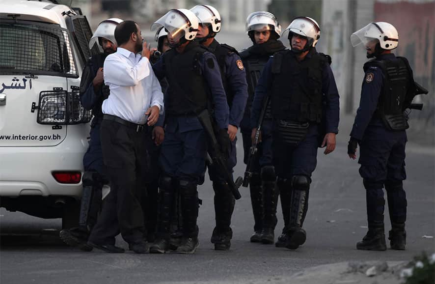 Riot police detain a Bahraini anti-government protester, who was later released, during a planned protest in Muqshaa village, Bahrain. Stepped-up protests nationwide continued for the forth day amid heavy security.