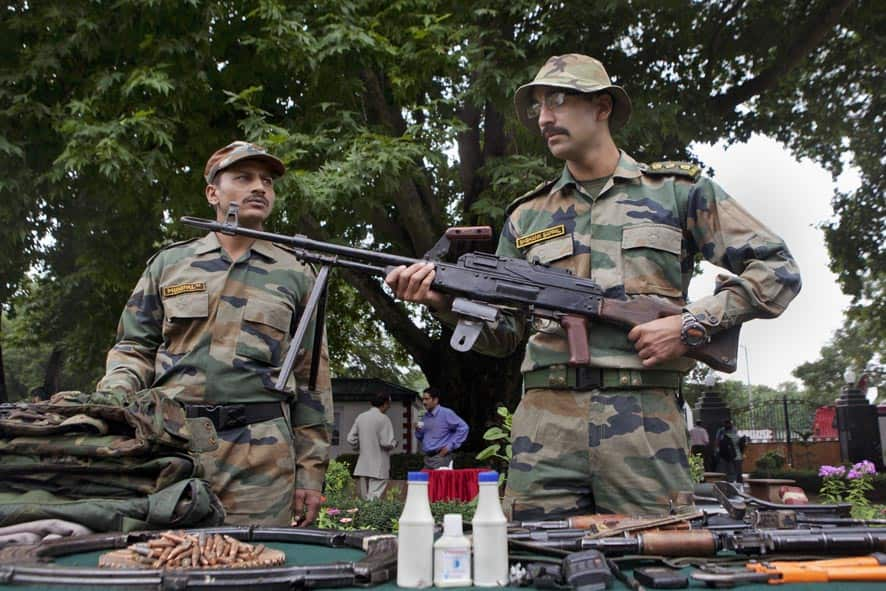 Indian army soldiers display seized arms and ammunition at the army headquarters in Srinagar.