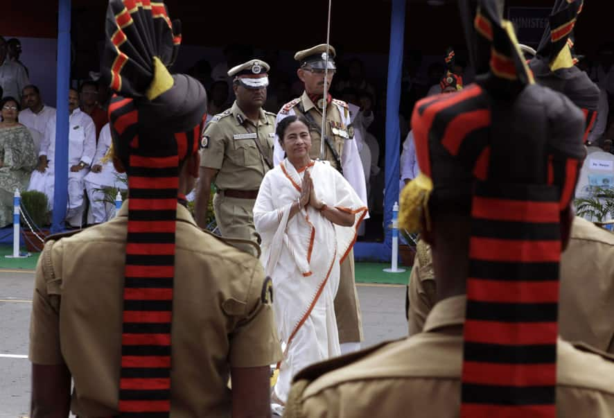West Bengal state Chief Minister Mamata Banerjee, center, gestures as she inspects the parade during India`s Independence Day celebrations in Kolkata.